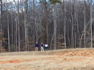 After their meeting, Lynsie and Bray walked their lot to see where their house would begin and end on the site and better envision their home-to-be.  It's always fun to stand right where a home will soon be!
