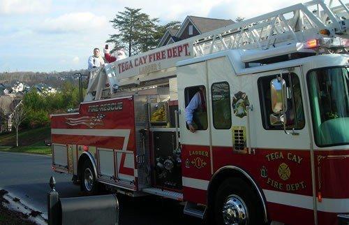 tega cay santa on a fire truck